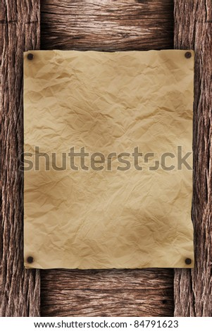 old paper on brown wood texture with natural patterns. Useful as background for design-works. - stock photo