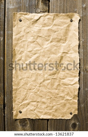 Old Paper On Dark Wooden Texture. Ready For Your message. - stock photo