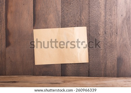Old paper  on grunge wood background		 - stock photo
