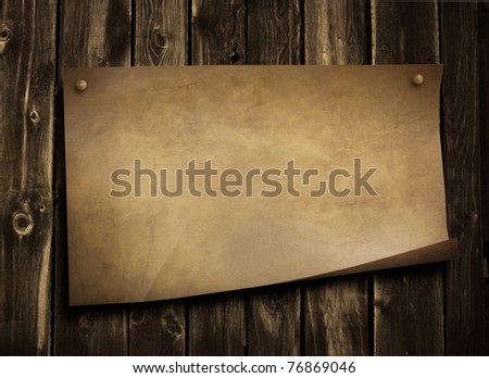 old paper on grunge wooden wall - stock photo