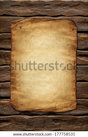 Old paper on log wall background with wood texture - stock photo