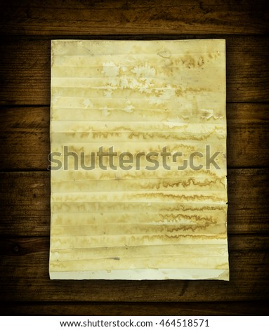 Old paper on old wood