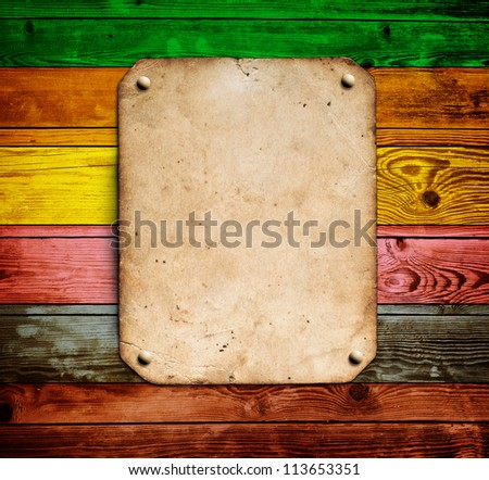 Old paper on the color wood background - stock photo