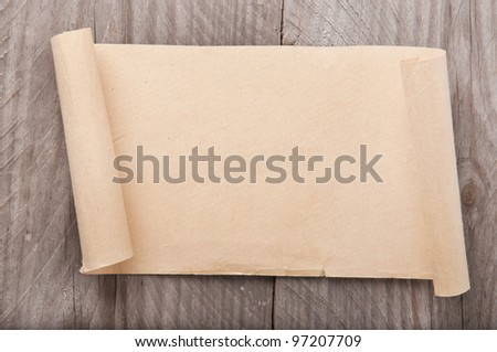 old paper on wood background - stock photo