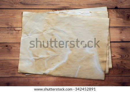 old paper on wood background and texture with space. - stock photo