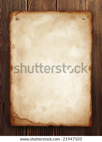 old paper on wood panel - stock photo