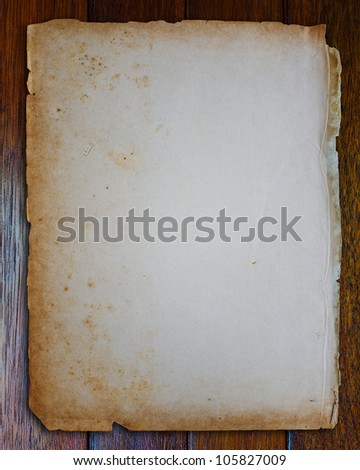 Old paper on wood table. - stock photo