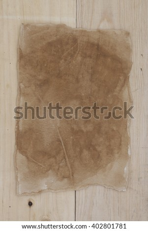 old paper on wooden background.