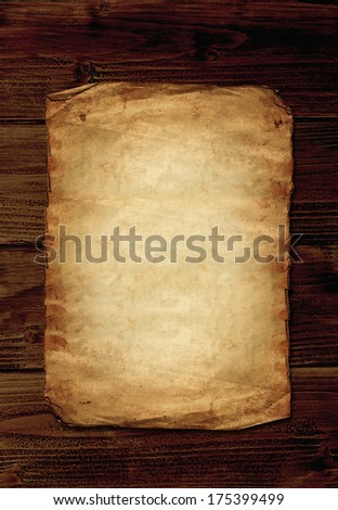 Old paper on wooden background with copyspace - stock photo