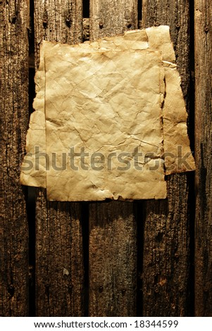 Old paper on wooden wall - stock photo