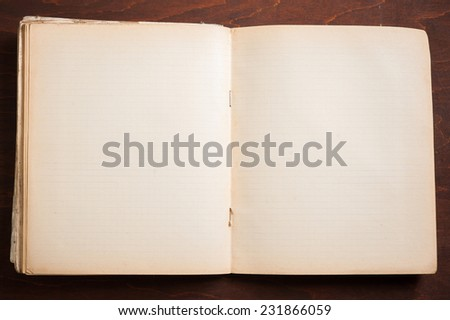 Old paper open aged blank exercise book notebook on dark wooden background