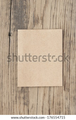 Old paper over an old wood background  - stock photo