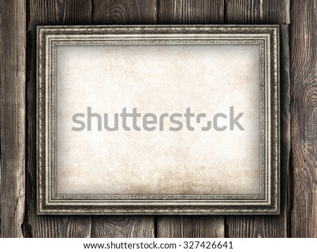 Old paper sheet in picture frame - stock photo