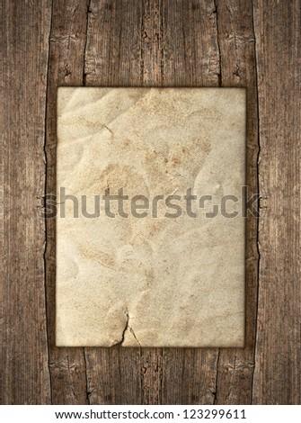 old paper sheet over rustic wooden background. grunge vintage backdrop - stock photo