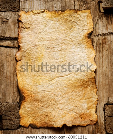 Old Paper sheet over wooden background - stock photo