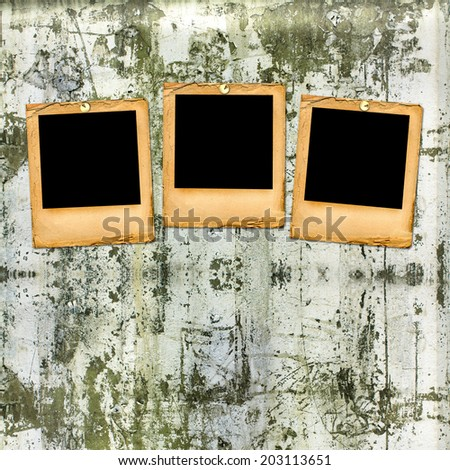 Old paper slides on the shabby brick wall background - stock photo