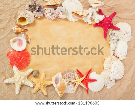 Old paper, starfishes and cockleshells - stock photo