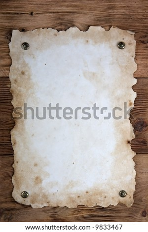 Old paper tacked to a wood wall - stock photo
