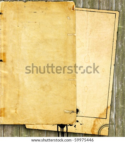 Old paper tacked to a wooden background - stock photo
