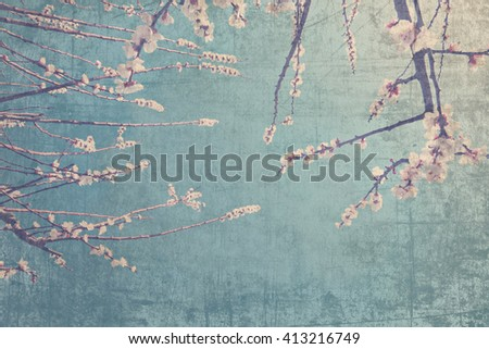 Old paper textured background with blossoming fruit tree against blue sky. Springtime nature abstract background - stock photo