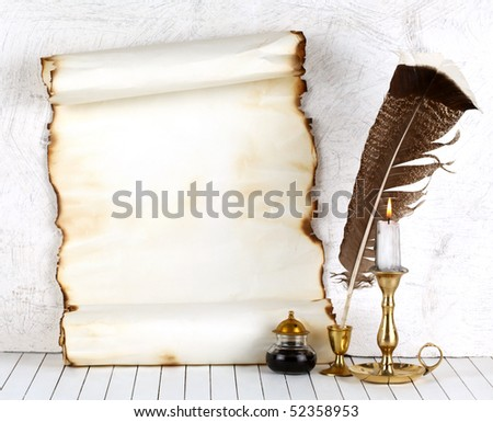 Old paper with a candle and a quill pen.On a white background. - stock photo