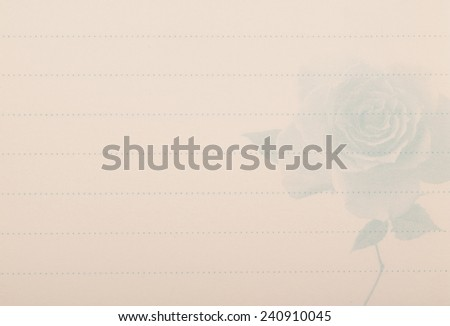 Old paper with a rose pattern - stock photo
