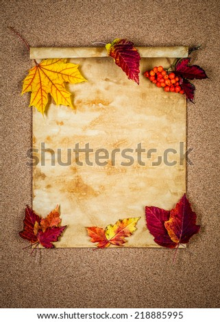 Old paper with autumn leaves autumn note - stock photo