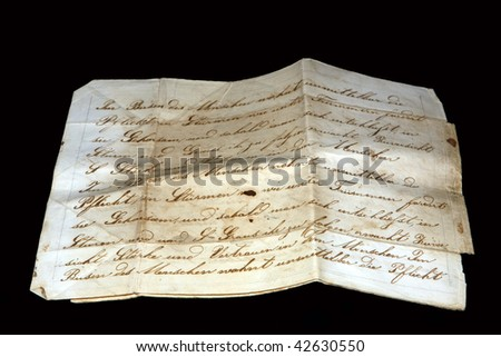 Old paper with cursive scripture isolated on black - stock photo