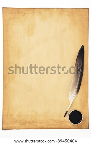 old paper with feather isolated on white background - stock photo