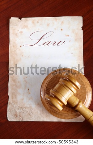 Old paper with word law and judges wooden gavel - stock photo