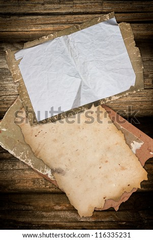Old papers on a wooden background