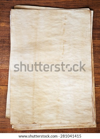 old papers on wooden background - stock photo