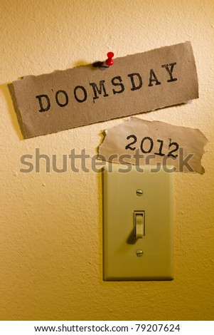 Old papers with the words Doomsday and 2012 next to a light switch representing the end of the world. - stock photo