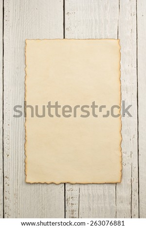 old parchment at wooden background texture - stock photo