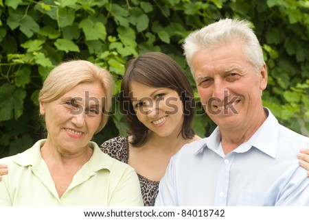 old parents with cute daughter at nature