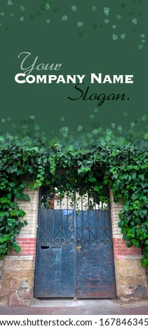 Old parisin door with a number plate and ivy - stock photo