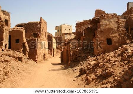 Old part (citadel) of desert town Mut in Dakhla oazis in Egypt, people still live here - stock photo
