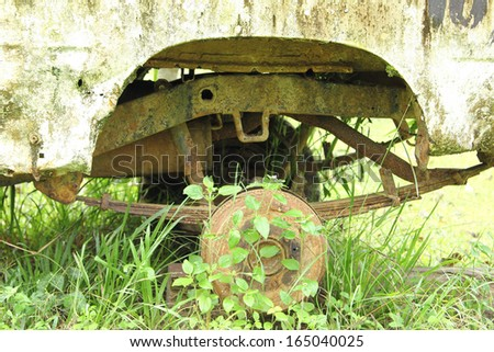 Old part of wheel car ,nobody come to repair in the garden - stock photo