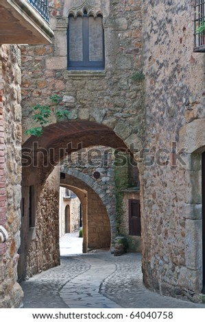 Old passageway in Peratallada, Spain - stock photo
