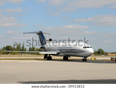 Old passenger jet airplane with missing engines - stock photo
