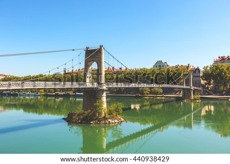 Old Passerelle du College bridge over Rhone river in Lyon, France. Summer day - stock photo