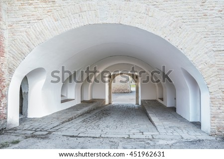 Old pathway through the medieval gate in bastion fortress in Slovakia city Komarno . - stock photo