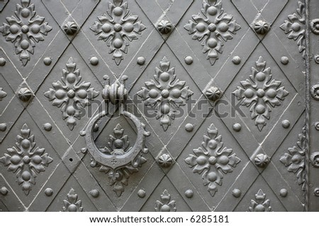Old pattern gate with a knocker in Konopiste Chateau near Prague, Czech Republic - stock photo
