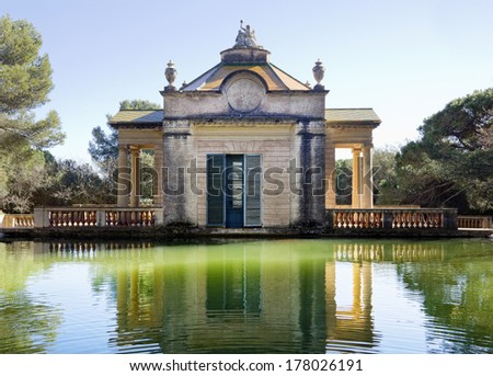 Old pavilion with pond water in Horta Labyrinth, Barcelona city, Catalonia, Spain - stock photo