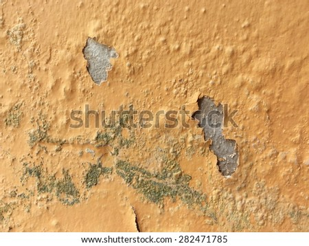 Old peeling paint and dirty on old orange concrete wall background - stock photo