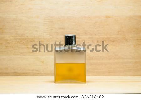 old perfume on wooden texture - stock photo