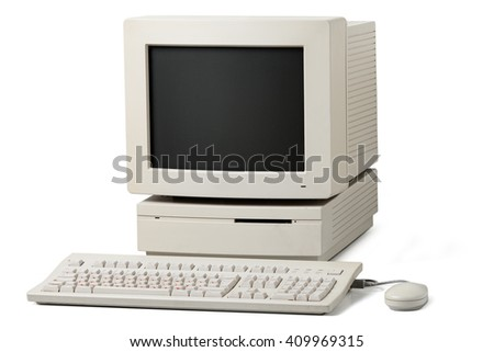 Old personal computer. The system unit, monitor, keyboard and mouse isolated on white background. - stock photo