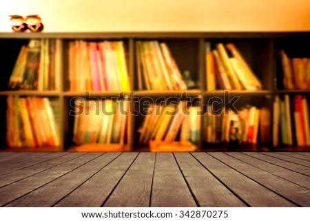 old perspective wooden floor on blur book shelf background - stock photo