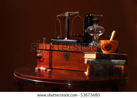 old pharmacist stuff, bottles, scales and mortar
