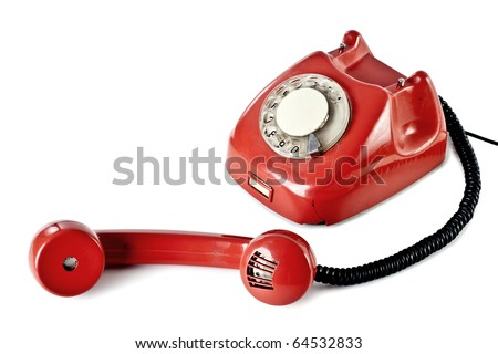 Old phone on the isolated white background - stock photo